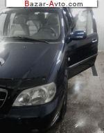 2004 KIA Carnival 2.9 CRDi AT (142 л.с.)  автобазар